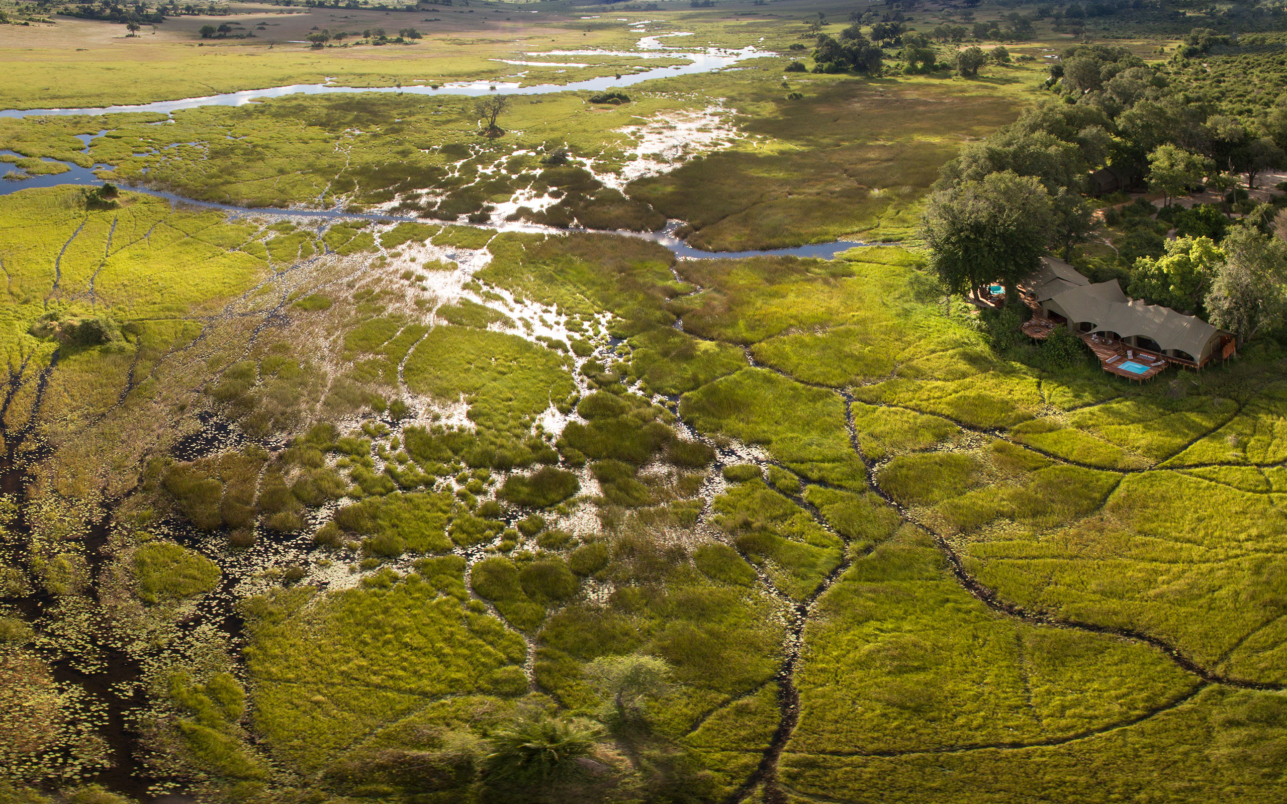 duba plains camp suites aerial panorama enkosi africa botswana delta okavango safari
