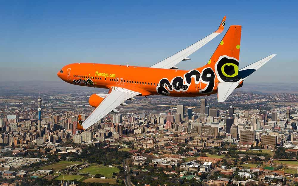 enkosi-africa-safari-mango-airlines-plane-over-johannesburg